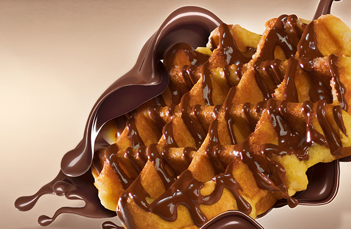 Fresh waffles with warm Lindt chocolate sauce